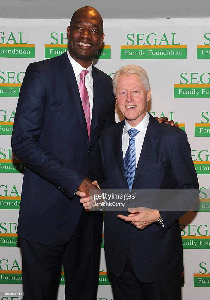 Former NBA player <a gi-track='captionPersonalityLinkClicked' href=/galleries/search?phrase=Dikembe+Mutombo&family=editorial&specificpeople=201659 ng-click='$event.stopPropagation()'>Dikembe Mutombo</a> and former US President <a gi-track='captionPersonalityLinkClicked' href=/galleries/search?phrase=Bill+Clinton&family=editorial&specificpeople=67203 ng-click='$event.stopPropagation()'>Bill Clinton</a> attend the Segal Family Foundation Meeting On Africa at Lighthouse International Conference Center on May 30, 2013 in New York City.