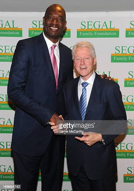 Former NBA player Dikembe Mutombo and former US President Bill Clinton attend the Segal Family Foundation Meeting On Africa at Lighthouse...