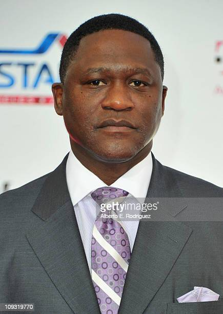 Former NBA player Dominique Wilkins arrives to the TMobile Magenta Carpet at the 2011 NBA AllStar Game on February 20 2011 in Los Angeles California