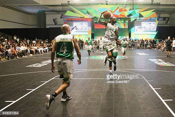 Former NBA player Doug Christie and recording artist Snoop Dogg participate in the celebrity basketball game presented by Sprite during the 2016 BET...