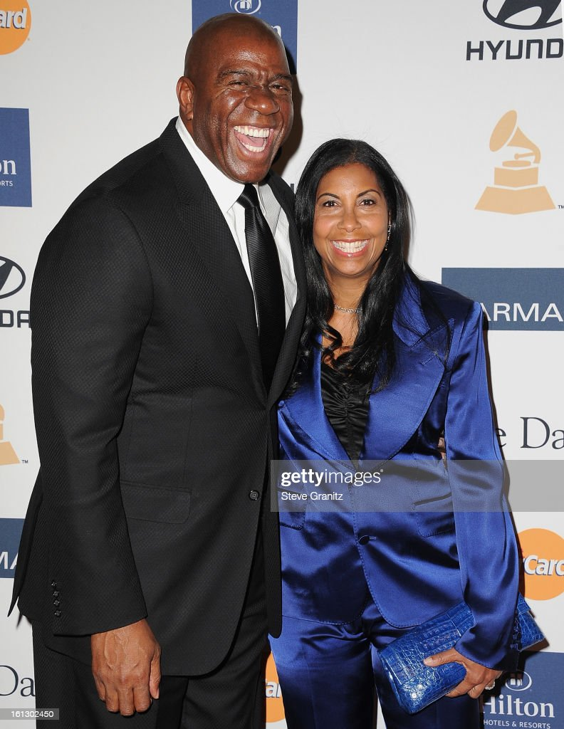 Former NBA player Earvin 'Magic' Johnson (L) and <a gi-track='captionPersonalityLinkClicked' href=/galleries/search?phrase=Cookie+Johnson&family=editorial&specificpeople=846852 ng-click='$event.stopPropagation()'>Cookie Johnson</a> arrive at the 55th Annual GRAMMY Awards Pre-GRAMMY Gala and Salute to Industry Icons honoring L.A. Reid held at The Beverly Hilton on February 9, 2013 in Los Angeles, California.
