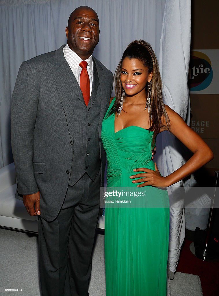 Former NBA player Earvin 'Magic' Johnson (L) and television and radio personality <a gi-track='captionPersonalityLinkClicked' href=/galleries/search?phrase=Claudia+Jordan&family=editorial&specificpeople=702294 ng-click='$event.stopPropagation()'>Claudia Jordan</a> arrive at the Glade Suite at the Soul Train Awards 2012 at PH Live at Planet Hollywood Resort & Casino on November 8, 2012 in Las Vegas, Nevada.