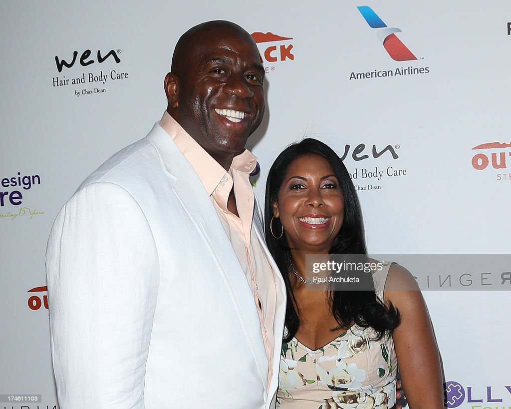 Former NBA Player Earvin 'Magic' Johnson (L) attends the 15th annual DesignCare charity event on July 27, 2013 in Malibu, California.