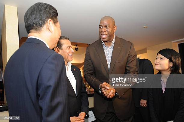 Former NBA player Earvin 'Magic' Johnson greets Chinese Vice President Xi Jinping during a game between the Phoenix Suns and the Los Angeles Lakers...