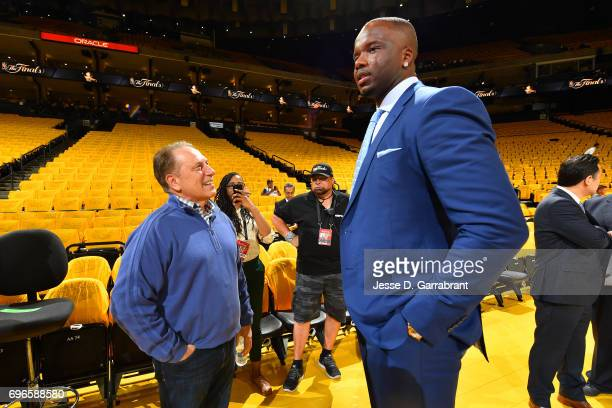 Former NBA player Jermaine O'Neal talks with Michigan State's men's basketball head coach Tom Izzo before Game One of the 2017 NBA Finals between the...