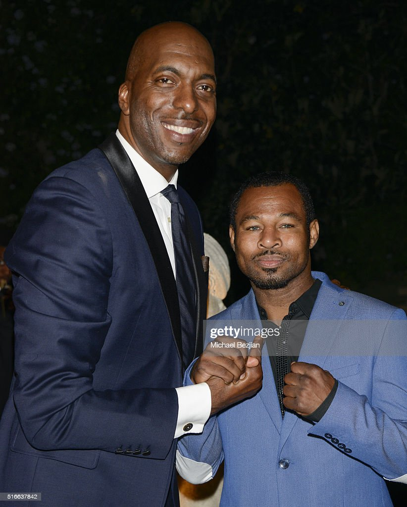 Former NBA player John Salley (L) and professional boxer Shane Mosley attend R.E.S.T.O.R.E: The Foundation For Reconstructive Surgery Charity Event on March 19, 2016 in Los Angeles, California.