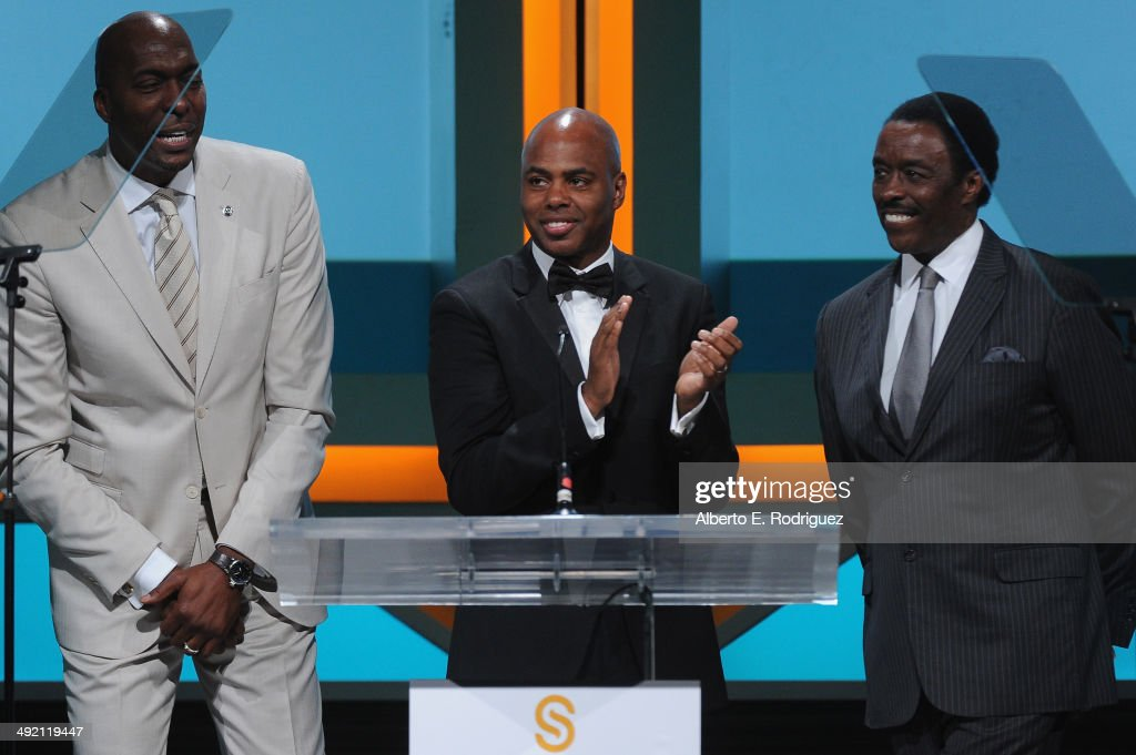 Former NBA player John Salley TV personalities Kevin Frazier and Jim Hill on stage at the 2014 Sports Spectacular Gala at the Hyatt Regency Century...