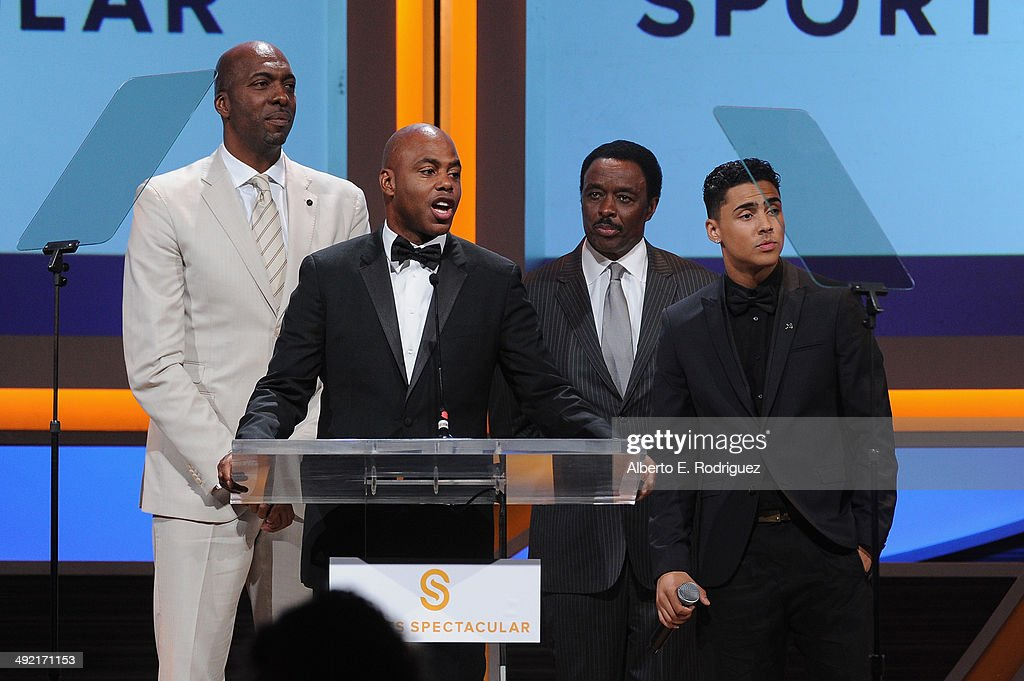 Former NBA player John Salley TV personalities Kevin Frazier Jim Hill and recording artist Quincy Combs on stage at the 2014 Sports Spectacular Gala...