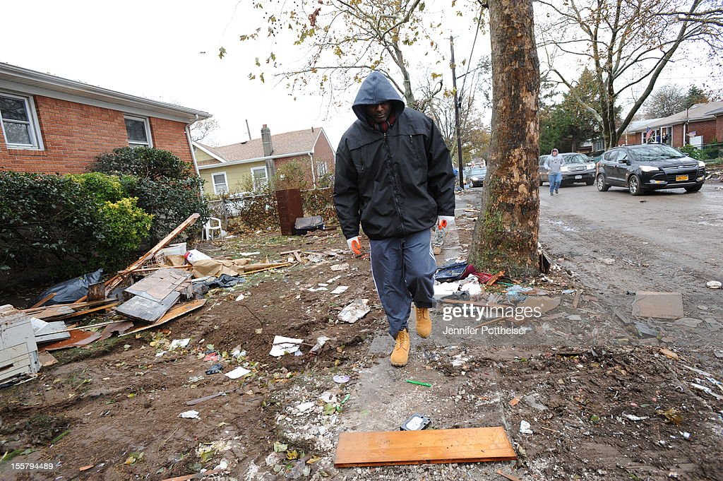 Former NBA player John Wallace walks around to assess the damage to residents in Staten Island, NY as part of NBA Cares Hurricane Sandy Relief Efforts on November 8, 2012 in Staten Island. NY.