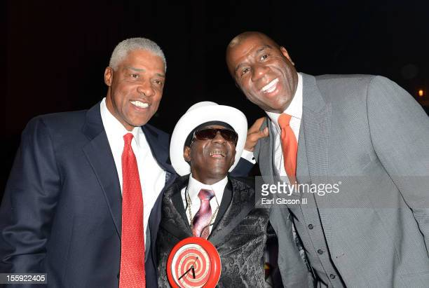 Former NBA player Julius 'Dr J' Erving rapper Flavor Flav and former NBA player 'Earvin 'Magic' Johnson are seen at the Soul Train Awards 2012 at PH...