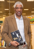 Former NBA player Julius Erving signs copies of his memoir 'Dr J The Autobiography' at Barnes Noble bookstore at The Grove on December 19 2013 in Los...