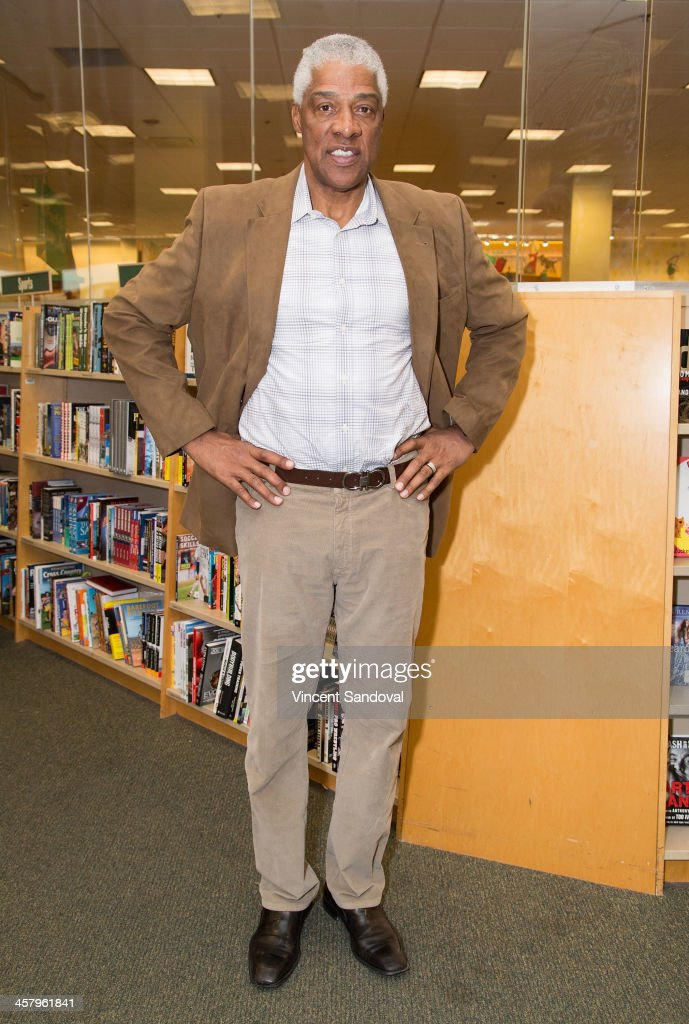 Former NBA player <a gi-track='captionPersonalityLinkClicked' href=/galleries/search?phrase=Julius+Erving&family=editorial&specificpeople=202966 ng-click='$event.stopPropagation()'>Julius Erving</a> signs copies of his memoir 'Dr.