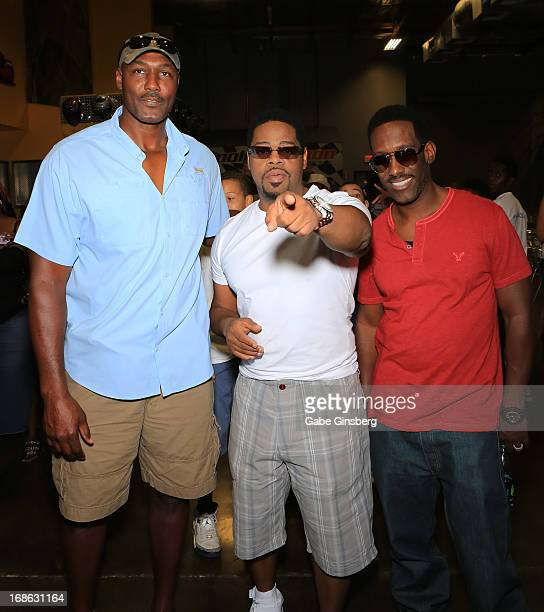 Former NBA player Karl Malone and singers Nathan Morris and Shawn Stockman of the group Boyz II Men attend a Boyz II Men House charity event to...