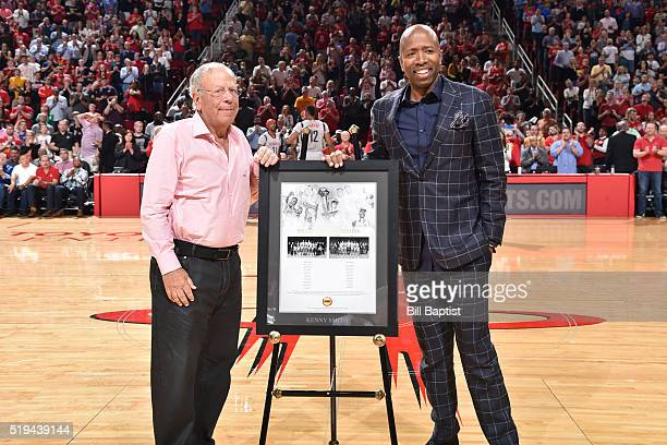 Former NBA player Kenny Smith is honored by Houston Rockets Owner Leslie Alexander during halftime of the game against the Oklahoma City Thunder on...