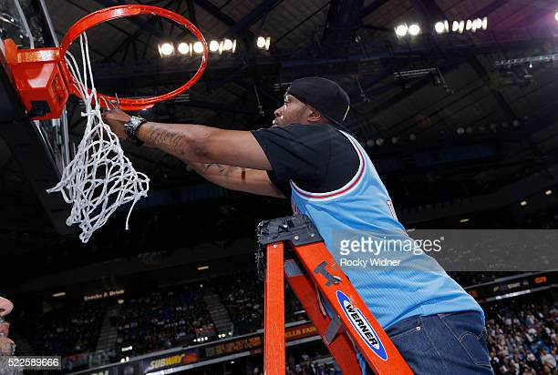 Former NBA player Kenny Thomas cuts a piece of the net after the final game at Sleep Train Arena between the Oklahoma City Thunder and Sacramento...