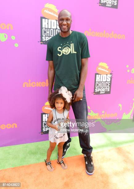 Former NBA player Lamar Odom and guest attend Nickelodeon Kids' Choice Sports Awards 2017 at Pauley Pavilion on July 13 2017 in Los Angeles California