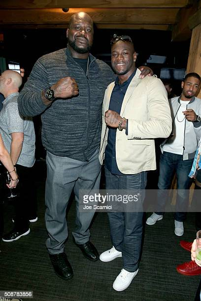 Former NBA player Shaquille O'Neal and professional boxer Deontay Wilder attend the Fanatics Super Bowl Party on February 6 2016 in San Francisco...