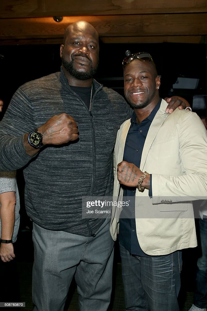 Former NBA player Shaquille O'Neal and professional boxer Deontay Wilder attend the Fanatics Super Bowl Party on February 6, 2016 in San Francisco, California.