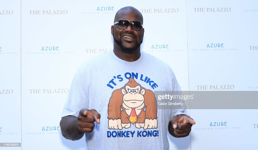 Former NBA player <a gi-track='captionPersonalityLinkClicked' href=/galleries/search?phrase=Shaquille+O%27Neal&family=editorial&specificpeople=201463 ng-click='$event.stopPropagation()'>Shaquille O'Neal</a> arrives at the Azure Luxury Pool at The Palazzo Las Vegas on August 18, 2013 in Las Vegas, Nevada.