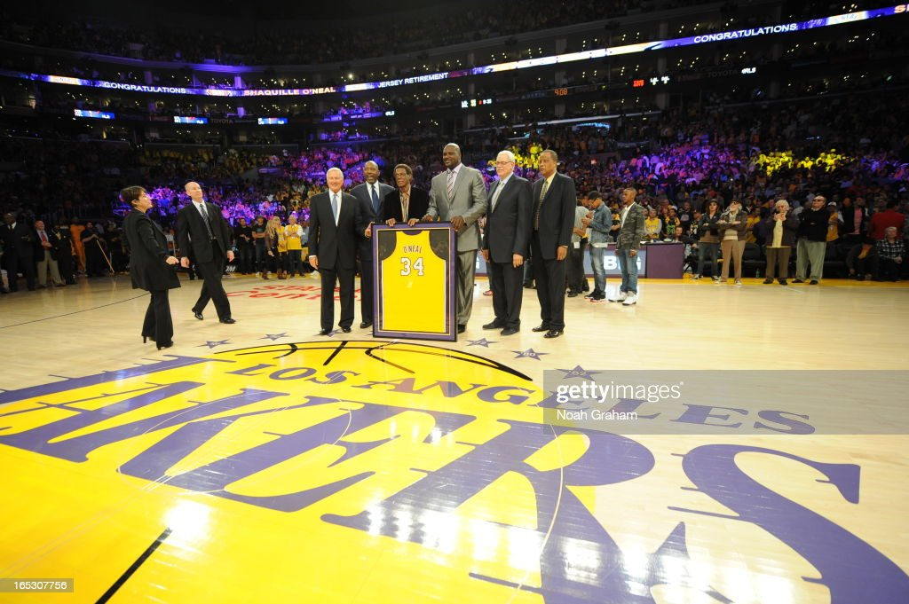 Former NBA player Shaquille O'Neal (C) poses for a photograph with Jerry West, James Worthy, Elgin Baylor, Phil Jackson, and Jamaal Wilkes during his jersey retirement ceremony at Staples Center on April 2, 2013 in Los Angeles, California.