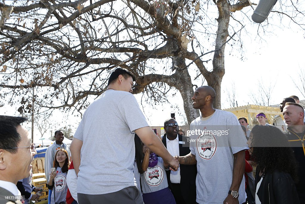 Former NBA player Yao Ming greets Kobe Bryant #24 of the Los Angeles Lakers at the 2013 NBA Cares Day of Service at the Playground Build with KaBOOM! on February 15, 2013 in Houston, Texas.