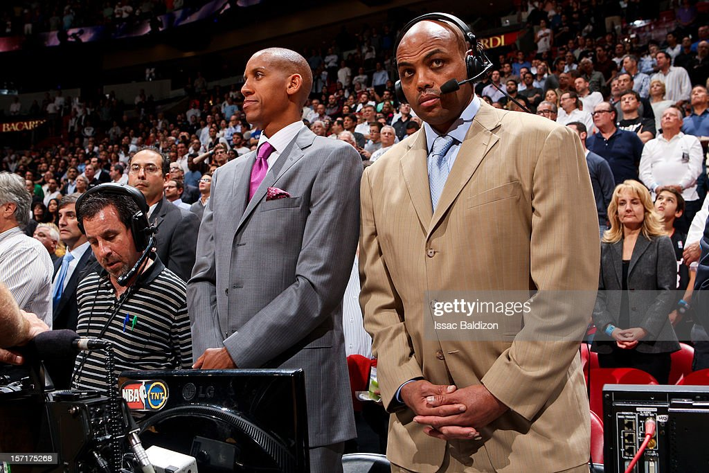 Former NBA players and current TNT commentators Reggie Miller, left, and Charles Barkley listen to the National Anthem before a game between the San Antonio Spurs and Miami Heat against on November 29, 2012 at American Airlines Arena in Miami, Florida.