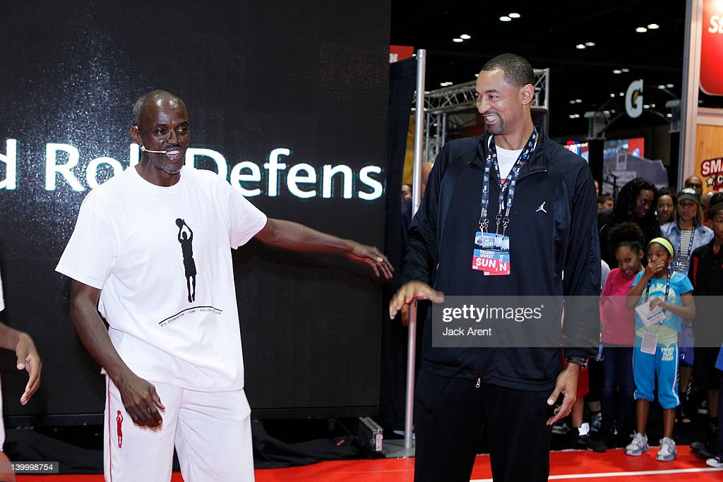 Former NBA players Craig Hodges is surprised by <a gi-track='captionPersonalityLinkClicked' href=/galleries/search?phrase=Juwan+Howard&family=editorial&specificpeople=201642 ng-click='$event.stopPropagation()'>Juwan Howard</a> when he made an un scheduled visit at Jam Session during All Star Weekend on February 26, 2012 in Orlando, Florida.