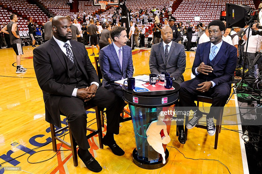 Former NBA players, from right, Chris Webber, Kenny Smith, NBA analyst Matt Winer, and Shaquille O'Neal, speak during an NBA TV broadcast before the San Antonio Spurs played the Miami Heat in Game One of the 2013 NBA Finals on June 6, 2013 at American Airlines Arena in Miami, Florida.