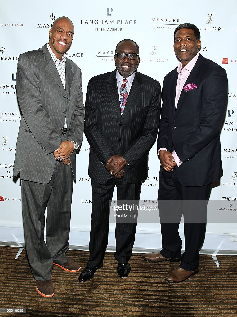 Former NBA players Jerome Williams Earl 'the Pearl' Monroe and Larry Johnson pose for a photo at the Party with the Pros at Langham Place New York...