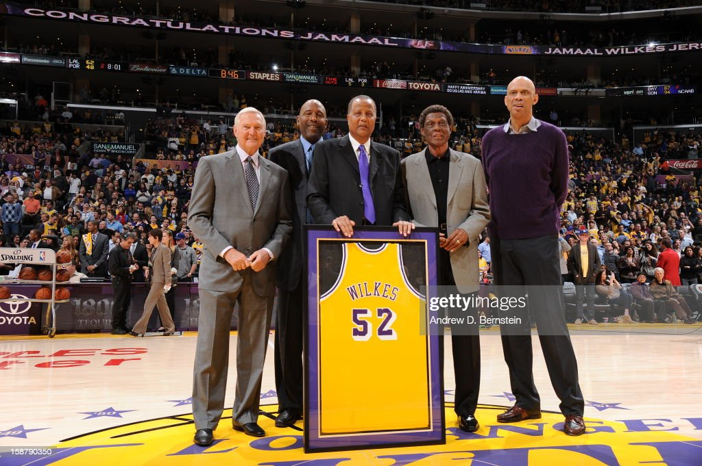 Former NBA players Jerry West, James Worthy, Jamaal Wilkes, Elgin Baylor, and Kareem Abdul-Jabbar pose for a photograph during the jersey retirement ceremony of Jamaal Wilkes at halftime of the game between the Portland Trail Blazers and the Los Angeles Lakers at Staples Center on December 28, 2012 in Los Angeles, California.