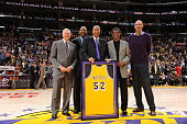 Former NBA players Jerry West James Worthy Jamaal Wilkes Elgin Baylor and Kareem AbdulJabbar pose for a photograph during the jersey retirement...
