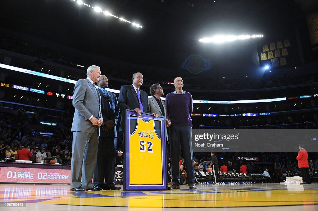 Former NBA players Jerry West, James Worthy, Jamaal Wilkes, Elgin Baylor, and Kareem Abdul-Jabbar pose for a photograph during the jersey retirement ceremony of Jamaal Wilkes at halftime of a game between the Portland Trail Blazers and the Los Angeles Lakers at Staples Center on December 28, 2012 in Los Angeles, California.