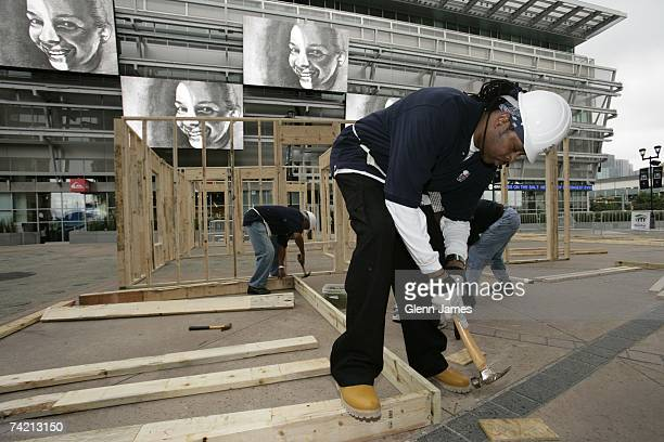 Former NBA players Sam Perkins helps Dallas Mavericks staff build a house for Habitat for Humanity in the plaza of the American Airlines Center on...