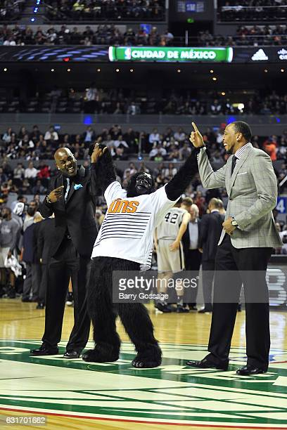 Former NBA players Shawn Marion and Gary Payton wave to the crowd with The Gorilla mascot of the Phoenix Suns during the San Antonio Spurs game...