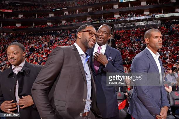 Former NBA players Steve Francis Tracy McGrady Dikembe Mutumbo and Shane Battier attend the Chicago Bulls against the Houston Rockets on February 3...