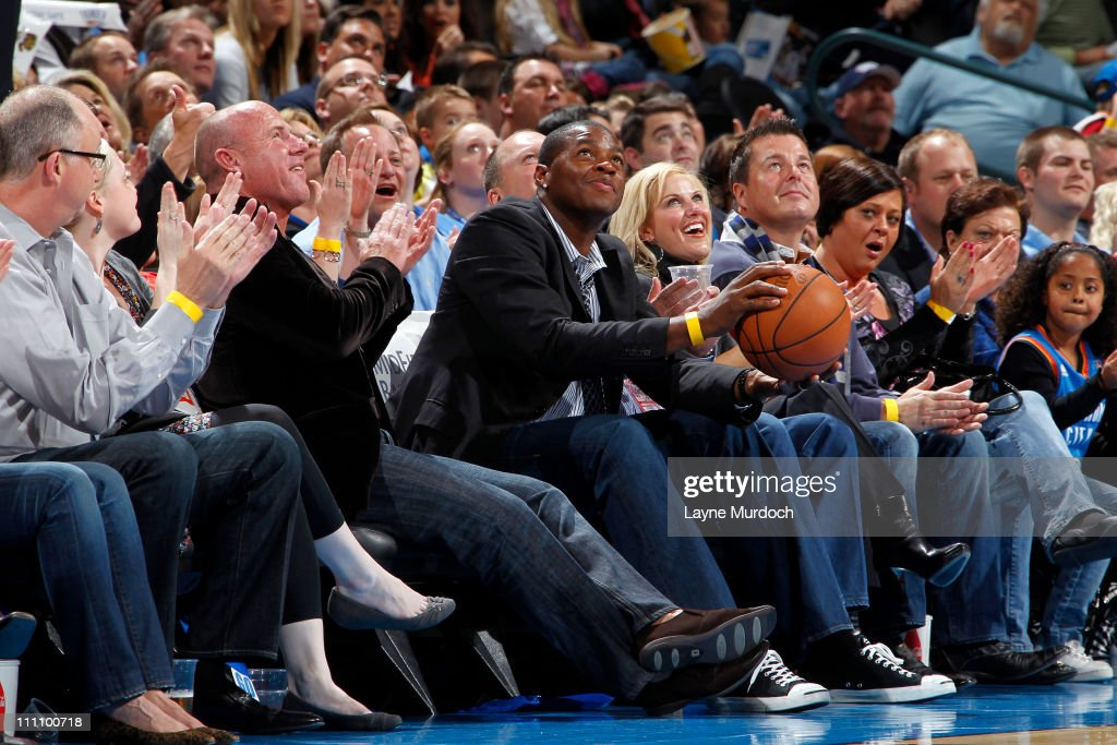 Former NBA star <a gi-track='captionPersonalityLinkClicked' href=/galleries/search?phrase=Desmond+Mason&family=editorial&specificpeople=201810 ng-click='$event.stopPropagation()'>Desmond Mason</a>, a member of the Oklahoma City Thunder in 2008-09, sits court side during the game against the Golden State Warriors on March 29, 2011 at the Oklahoma City Arena in Oklahoma City, Oklahoma.