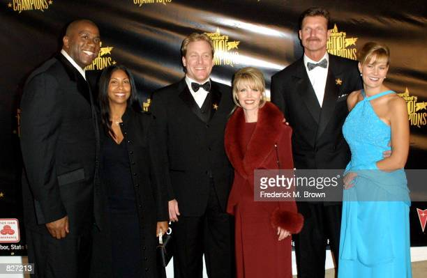 Former NBA star Earvin 'Magic' Johnson and his wife Cookie baseball pitcher Curt Schilling and his wife Shonda and baseball pitchcer Randy Johnson...