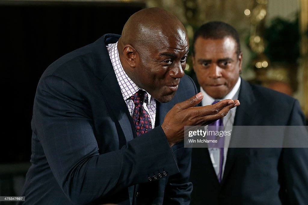 Former NBA star <a gi-track='captionPersonalityLinkClicked' href=/galleries/search?phrase=Magic+Johnson&family=editorial&specificpeople=157511 ng-click='$event.stopPropagation()'>Magic Johnson</a> greets guests during an event in the East Room of the White House February 27, 2014 in Washington, DC. During the event U.S. President Barack Obama signed an executive memorandum following remarks on the ÒMy BrotherÕs KeeperÓ initiative.