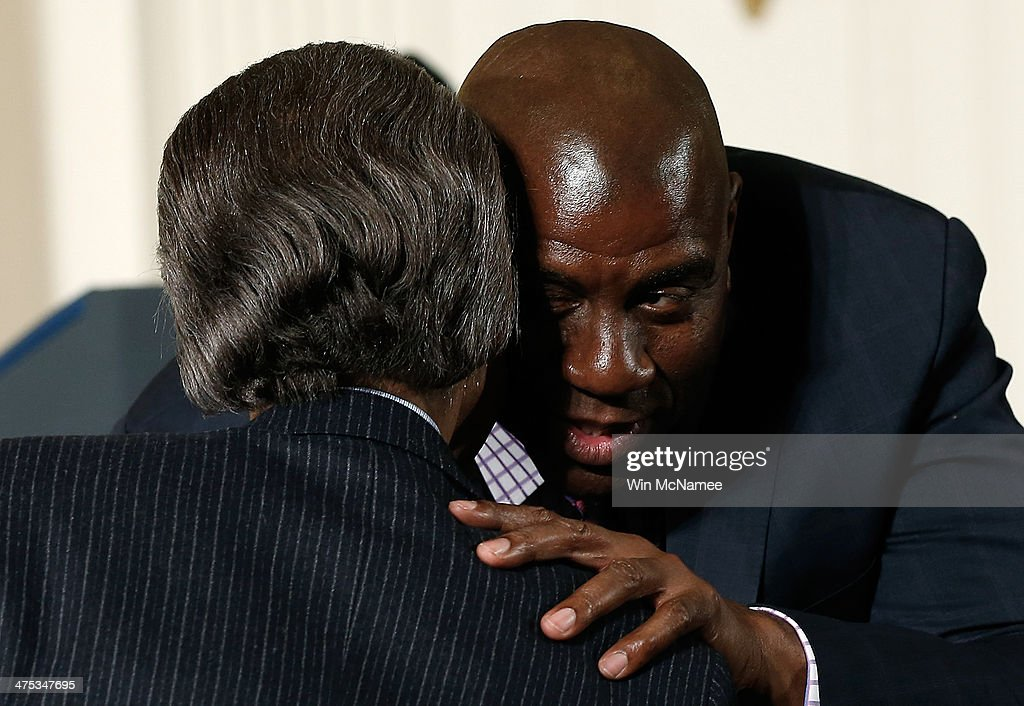 Former NBA star <a gi-track='captionPersonalityLinkClicked' href=/galleries/search?phrase=Magic+Johnson&family=editorial&specificpeople=157511 ng-click='$event.stopPropagation()'>Magic Johnson</a> greets the Rev. Al Sharpton during an event in the East Room of the White House February 27, 2014 in Washington, DC. During the event U.S. President Barack Obama signed an executive memorandum following remarks on the ÒMy BrotherÕs KeeperÓ initiative.