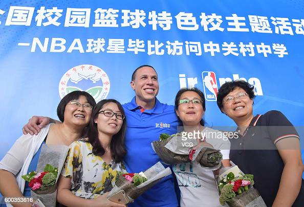Former NBA star Mike Bibby poses with students at ZhongGuanCun Middle School on September 8 2016 in Beijing China