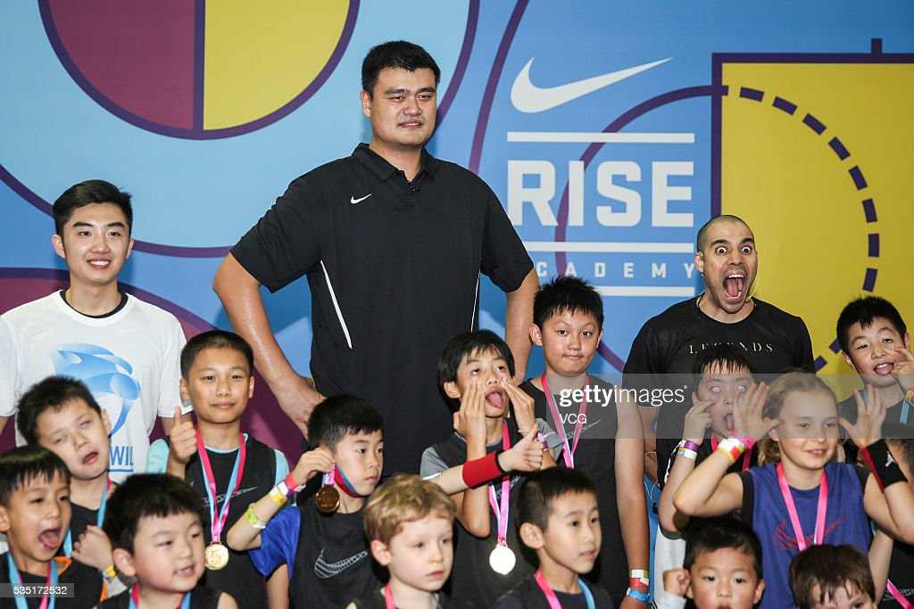 Former NBA star <a gi-track='captionPersonalityLinkClicked' href=/galleries/search?phrase=Yao+Ming&family=editorial&specificpeople=201476 ng-click='$event.stopPropagation()'>Yao Ming</a> poses with fans as he attends a basketball activity on May 29, 2016 in Shanghai, China.