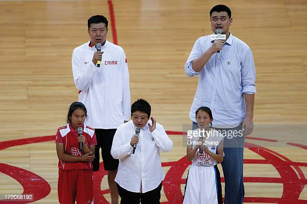 Former NBA star Yao Ming Sing the national anthem with Wang Zhizhi during the 2013 Yao Foundation Charity Game between China and the NBA Stars on...