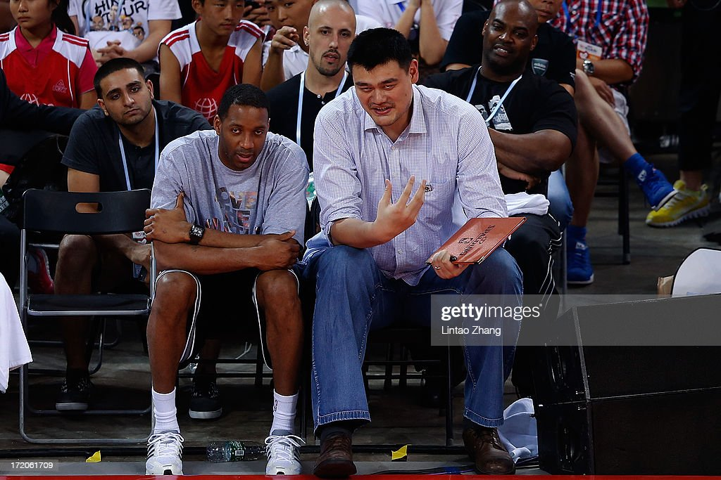 Former NBA star Yao Ming (R) talk with Tracy McGrady of the San Antonio Spurs during the 2013 Yao Foundation Charity Game between China and the NBA Stars on July 1, 2013 in Beijing, China.