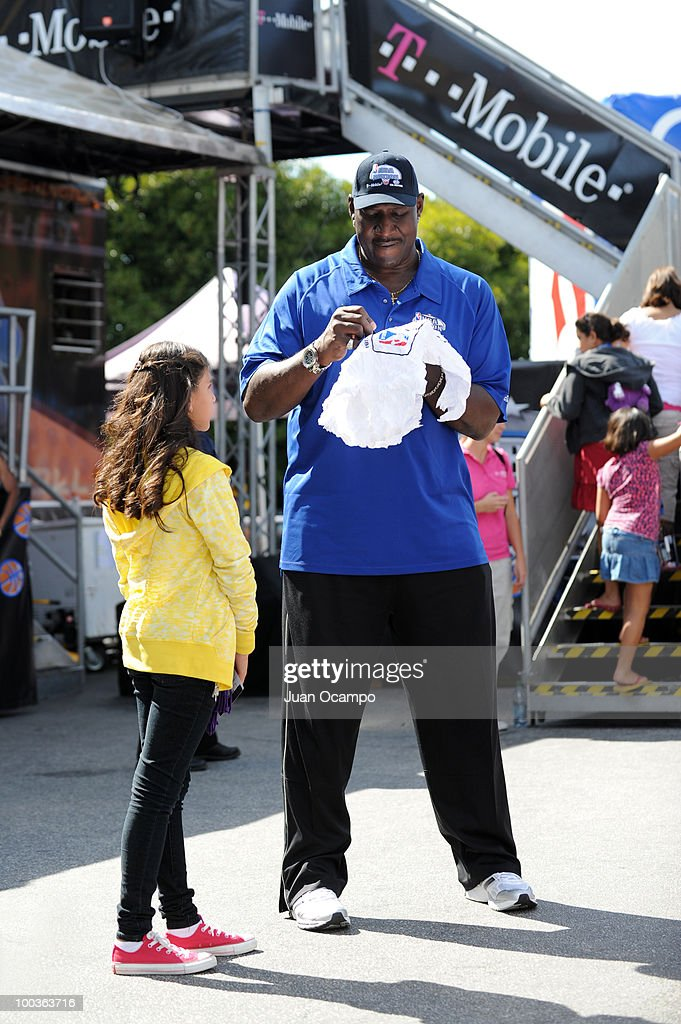 Former NBA superstar Darryl Dawkins signs an autograph for a young fan during the NBA Nation Tour on May 23, 2010 at Universal City Walk in Universal City, California.