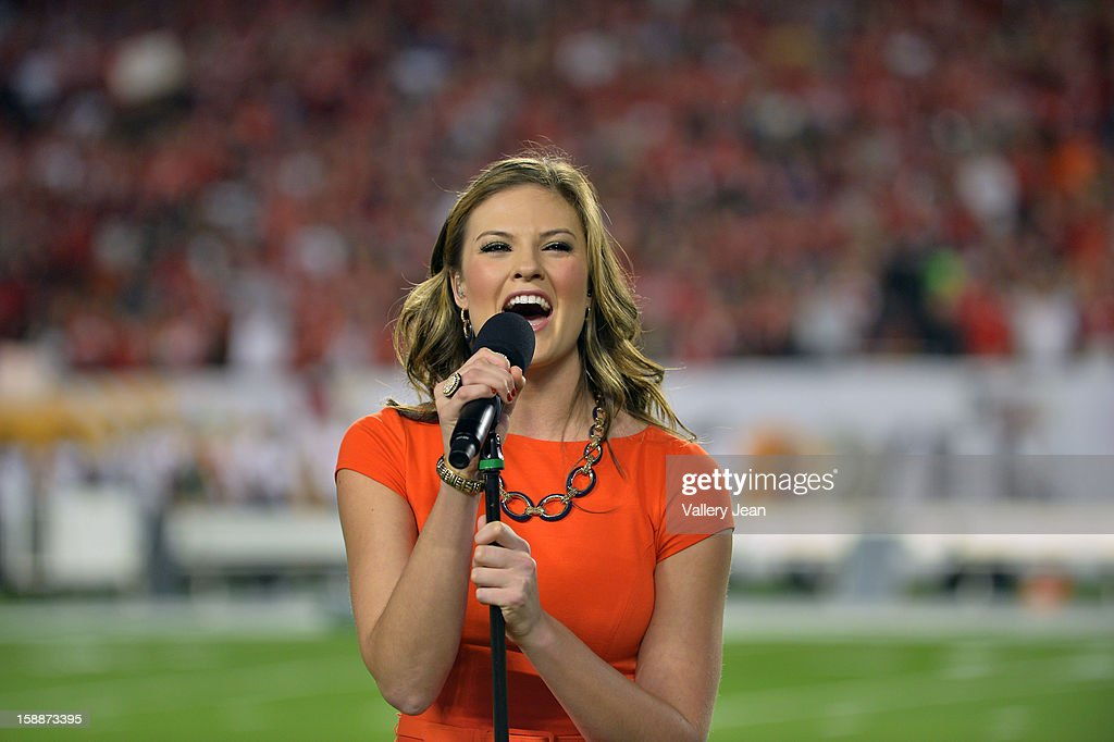 Former NCAA basketball player and contestant on American Idol on season 5 Ayla Brown performs the National Anthem and 'God Bless America' during the 2013 Discover Orange Bowl Countdown to Kickoff at Sunlife Stadium on January 1, 2013 in Miami, Florida.