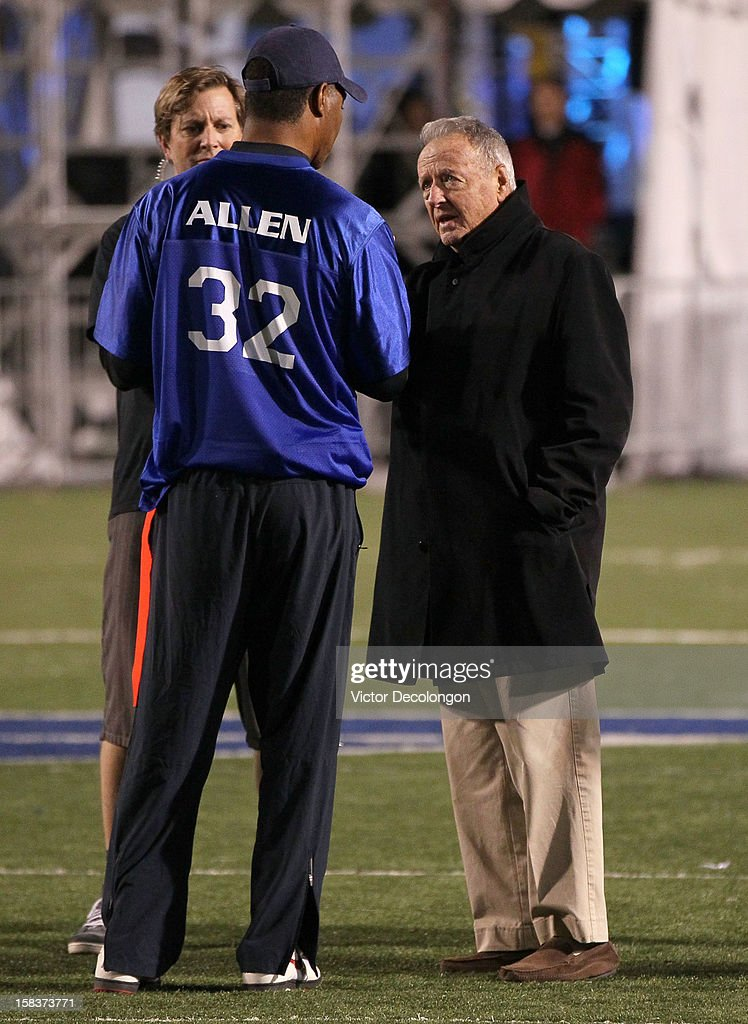 Former NCAA Football Coach Bobby Bowden (R) and former NFL player Marcus Allen confer on the field during the Got Your 6 And Pat Tillman Foundation benefit game on December 13, 2012 in Norwalk, California.