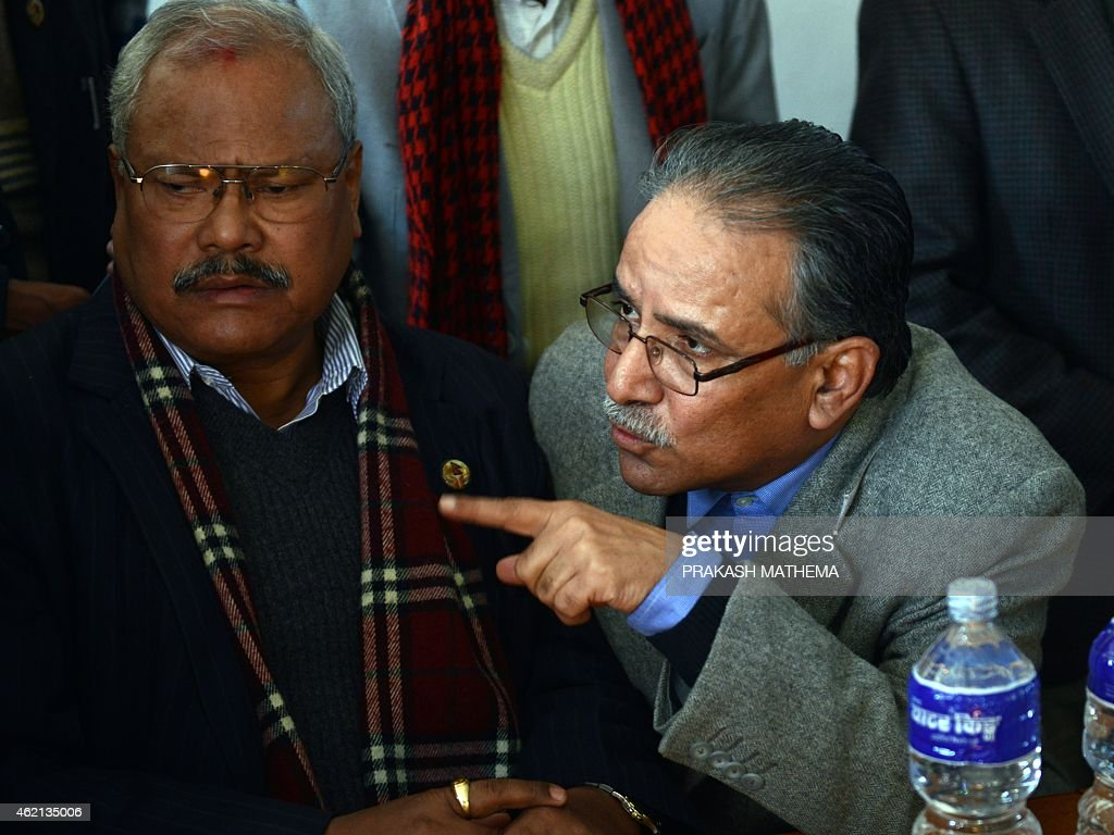 Former Nepalese Prime Minister and Unified Communist Party of Nepal (Maoist) chairman <a gi-track='captionPersonalityLinkClicked' href=/galleries/search?phrase=Pushpa+Kamal+Dahal&family=editorial&specificpeople=565314 ng-click='$event.stopPropagation()'>Pushpa Kamal Dahal</a> (R), also known as Prachanda, gestures as 19-party alliance leader Bijaya Kumar Gachedhar looks on during a press conference following their meeting in Kathmandu on January 25, 2015. Nepal's Parliamentary Speaker January 25 announced plans to hold a vote and end deadlock over disputed issues in the draft constitution, three days after lawmakers missed a deadline to approve the charter.