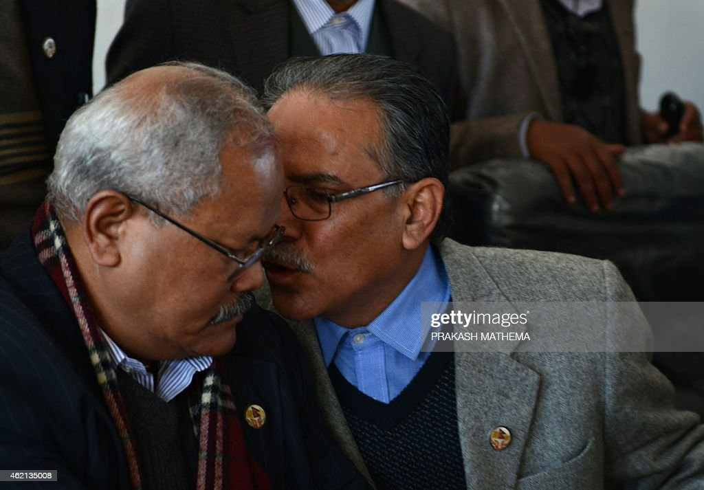 Former Nepalese Prime Minister and Unified Communist Party of Nepal (Maoist) chairman <a gi-track='captionPersonalityLinkClicked' href=/galleries/search?phrase=Pushpa+Kamal+Dahal&family=editorial&specificpeople=565314 ng-click='$event.stopPropagation()'>Pushpa Kamal Dahal</a> (R), also known as Prachanda, talks with 19-party alliance leader Bijaya Kumar Gachedhar during a press conference following their meeting in Kathmandu on January 25, 2015. Nepal's Parliamentary Speaker January 25 announced plans to hold a vote and end deadlock over disputed issues in the draft constitution, three days after lawmakers missed a deadline to approve the charter.
