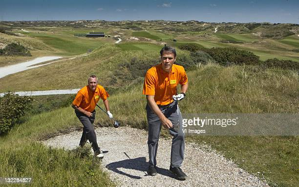 Former Netherlands football stars Johan Cruyff and Marco van Basten play golf at the Noordwijkse Golf Club on May 30 2011 in Noordwijk Netherlands