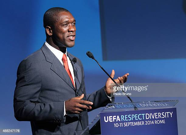 Former Netherlands international and AC Milan player Clarence Seedorf attends a UEFA Conference 'Respect Diversity' on September 11 2014 in Rome Italy